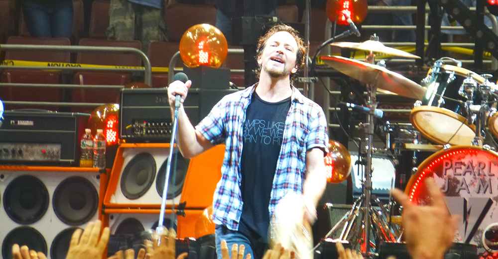 An image of Eddie Vedder performing live, as part of the dream Pearl Jam setlist article from Skipped on Shuffle.