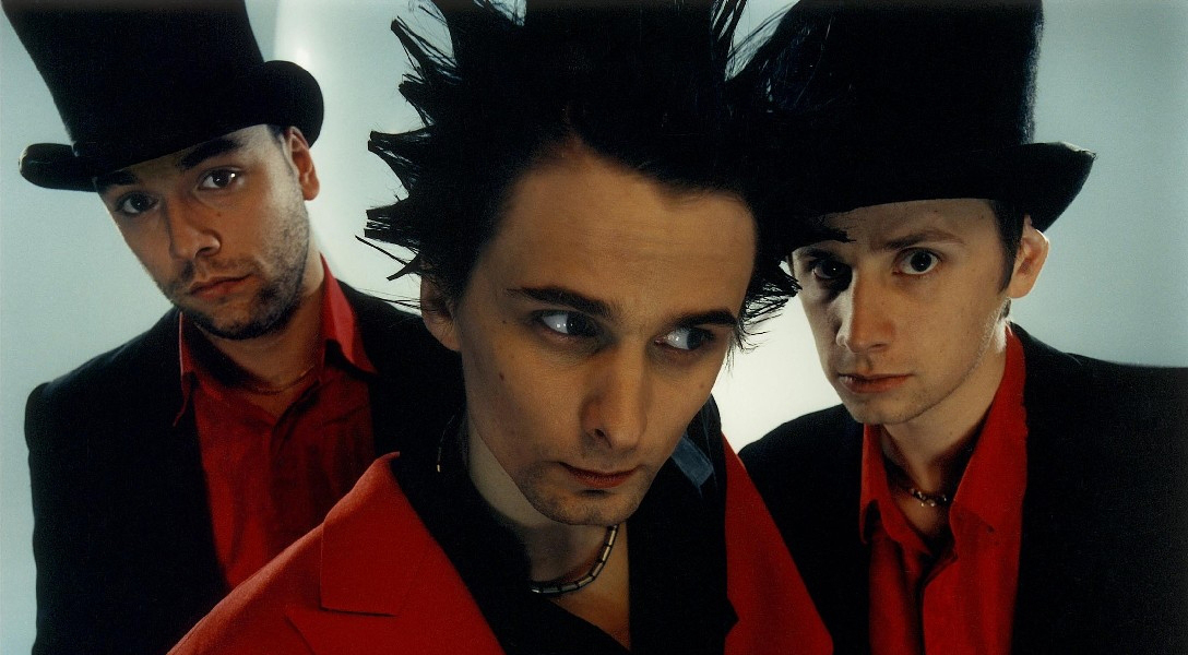An image of the three members of rock band Muse.