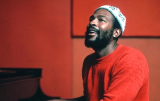 An Image of soul singer Marvin Gaye sitting at a piano.